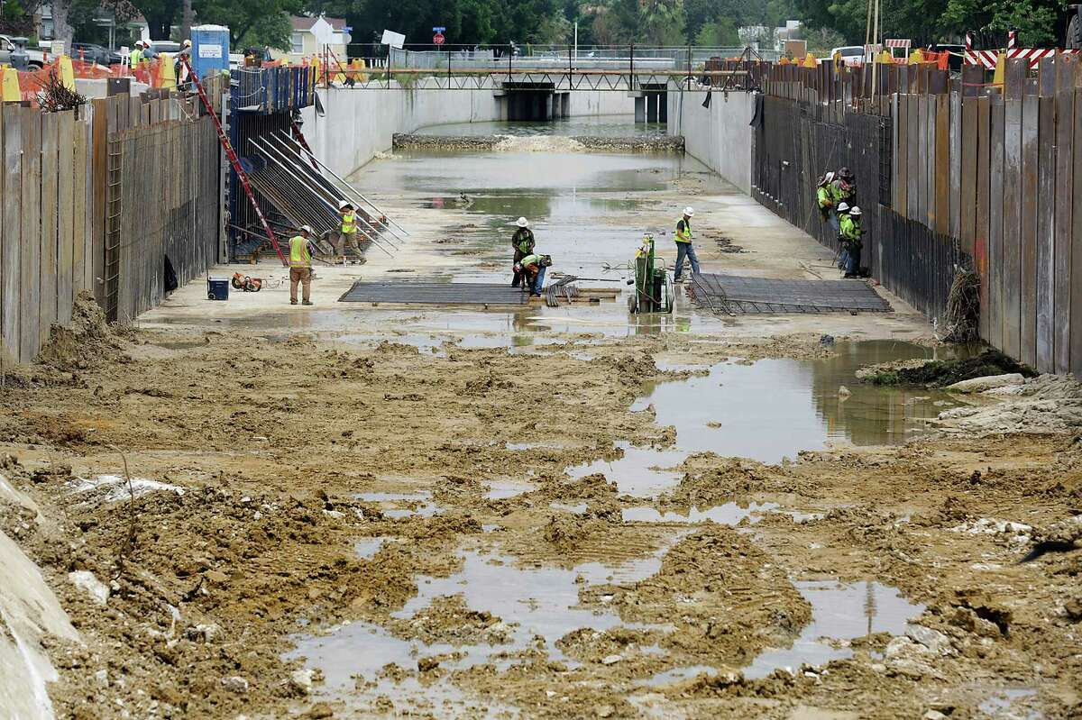 Crews work on the Seeling Channel Phase 2 Drainage Project at Wilson and West Mistletoe Avenue.