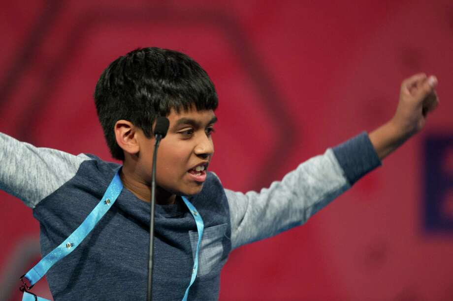 Nihar Janga, 11, of Austin celebrates after correctly spelling a word during the final round of the Scripps National Spelling Bee on Thursday.