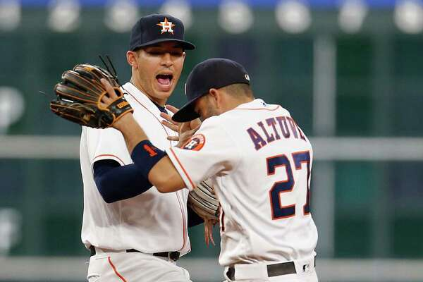 Houston Astros shortstop Carlos Correa (1) celebrates with Jose Altuve (27) after sweeping Baltimore Orioles in an MLB baseball game at Minute Maid Park,Thursday, May 26, 2016.