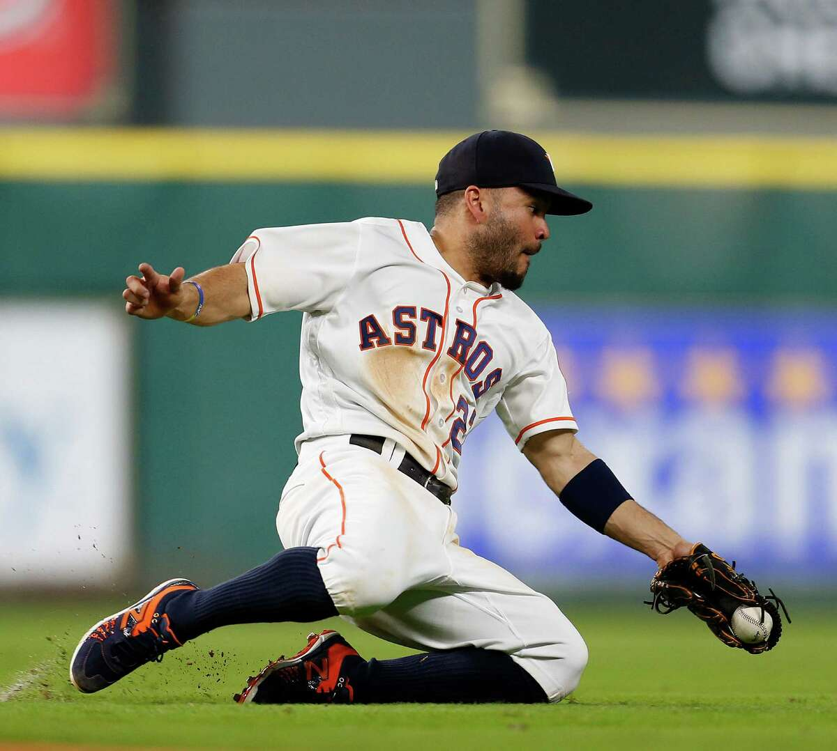 Houston Astros second baseman Jose Altuve (27) just misses catching Baltimore Orioles left fielder Hyun Soo Kim's single in the ninth inning of an MLB baseball game at Minute Maid Park,Thursday, May 26, 2016.