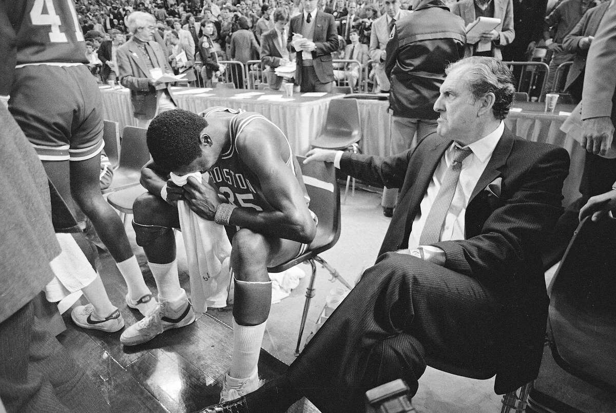 PHOTOS: See what the NCAA Tournament bracket looked like in 1984 Hakeem (then Akeem) Olajuwon (35) buries his head in a towel and cries after the Cougars of Houston lost their NCAA national title to Georgetown, 84-75, in Seattle, April 2, 1984. At right, coach Guy Lewis looks on.
