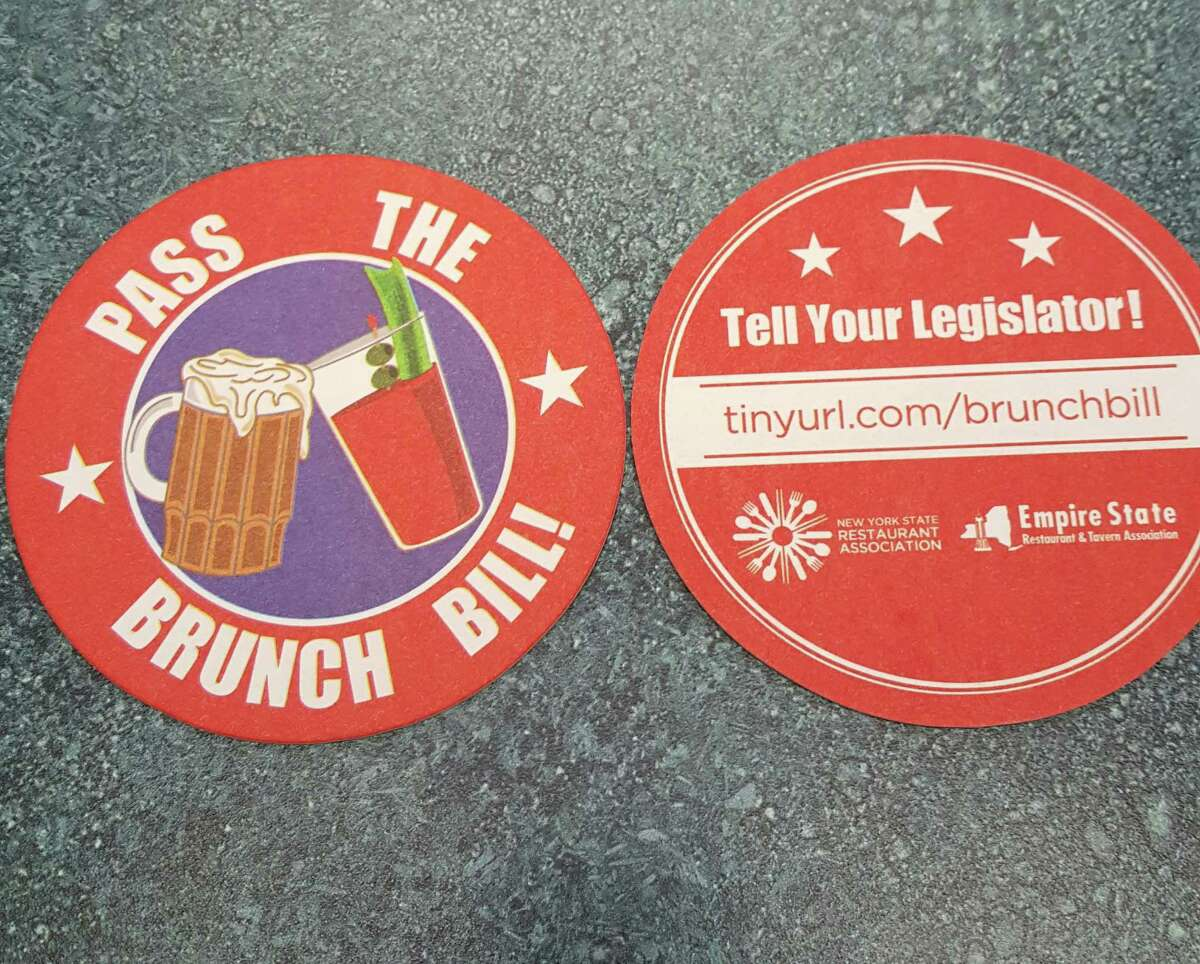 The state Restaurant Association and Empire State Restaurant and Tavern Association have turned to coasters as a tool to lobby for passage of the so-called brunch bill. That legislation would allow bars and restaurants to serve alcohol beginning at 8 a.m. on Sundays, four hours earlier than state law currently allows. ORG XMIT: MER2016052317311259