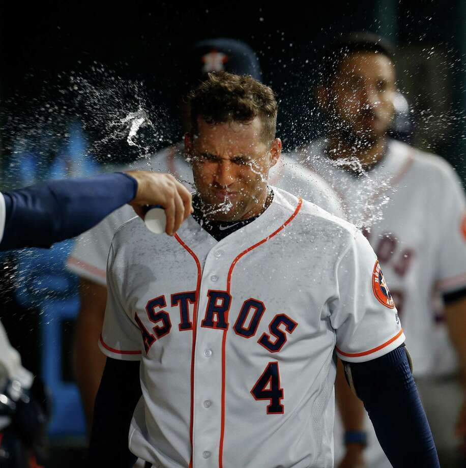 A dousing after a first-inning home run didn't cool off George Springer on Thursday night as he added another even longer homer in the fifth. Photo: Karen Warren, Staff / © 2016 Houston Chronicle