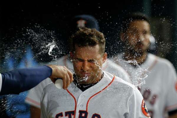 A dousing after a first-inning home run didn't cool off George Springer on Thursday night as he added another even longer homer in the fifth.