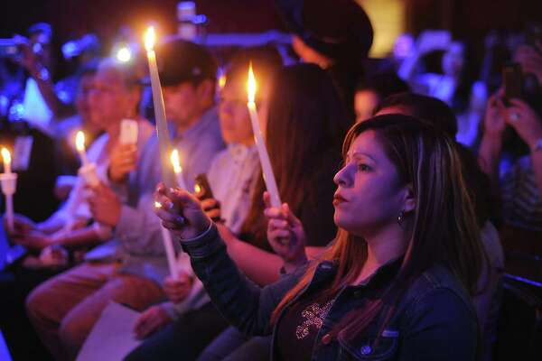 Fans hold candles while remembering Emilio at the Houston Loves Emilio candlelight vigil at the Dorado nightclub Thursday May 26,2016(Dave Rossman Photo)