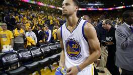 Golden State Warriors' Stephen Curry leaves the court after 120-111 win over Oklahoma Thunder in Game 5 of NBA Playoffs' Western Conference Finals at Oracle Arena in Oakland, Calif., on Thursday, May 26, 2016.