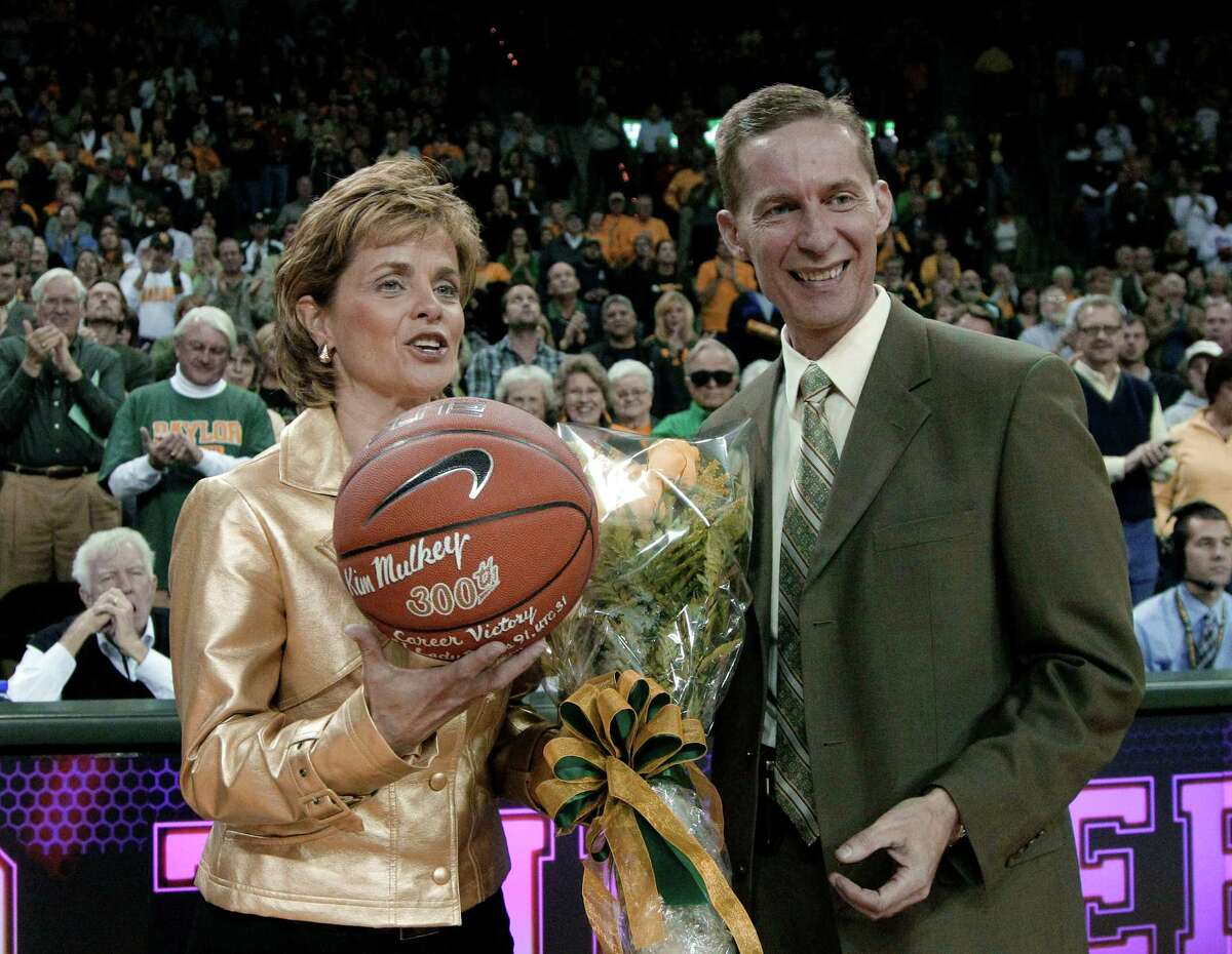 Baylor coach Kim Mulkey is given a basketball inscribed in honor of her 300th career victory, reached last Sunday, by athletic director Ian McCaw before a college basketball game Thursday Nov. 17, 2011, in Waco, Texas. (AP Photo/Tony Gutierrez)