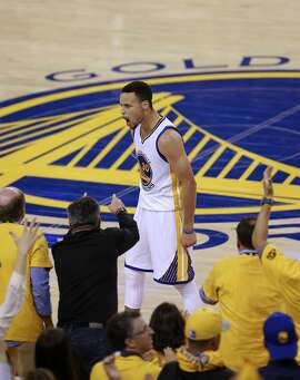Warriors' Stephen Curry, 30 fires up the fans after a lay up in the fourth quarter as the Golden State Warriors went on to beat the Oklahoma City Thunder 120-111 in game 5 of the Western Conference Finals at Oracle Arena on Thurs. May 26, 2016, in Oakland, California.