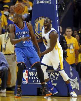 Golden State Warriors' Draymond Green celebrates a basket against Oklahoma City Thunder's Serge Ibaka during Warriors' 120-111 win in Game 5 of NBA Playoffs' Western Conference Finals at Oracle Arena in Oakland, Calif., on Thursday, May 26, 2016.