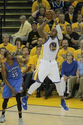 Golden State Warriors� Marreese Speights shoots over Oklahoma City Thunders� Kevin Durant in the fourth quarter during Game 5 of the NBA Western Conference Finals at Oracle Arena on Thursday, May 26, 2016 in Oakland, Calif.
