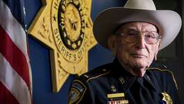Lt. Tom Morgan, of the Harris County Sheriff's Department, poses for a portrait on Tuesday, May 24, 2016, in Houston. Morgan, 95, is a World War II Marine combat veteran of Guadalcanal, Saipan and Okinawa. ( Brett Coomer / Houston Chronicle )