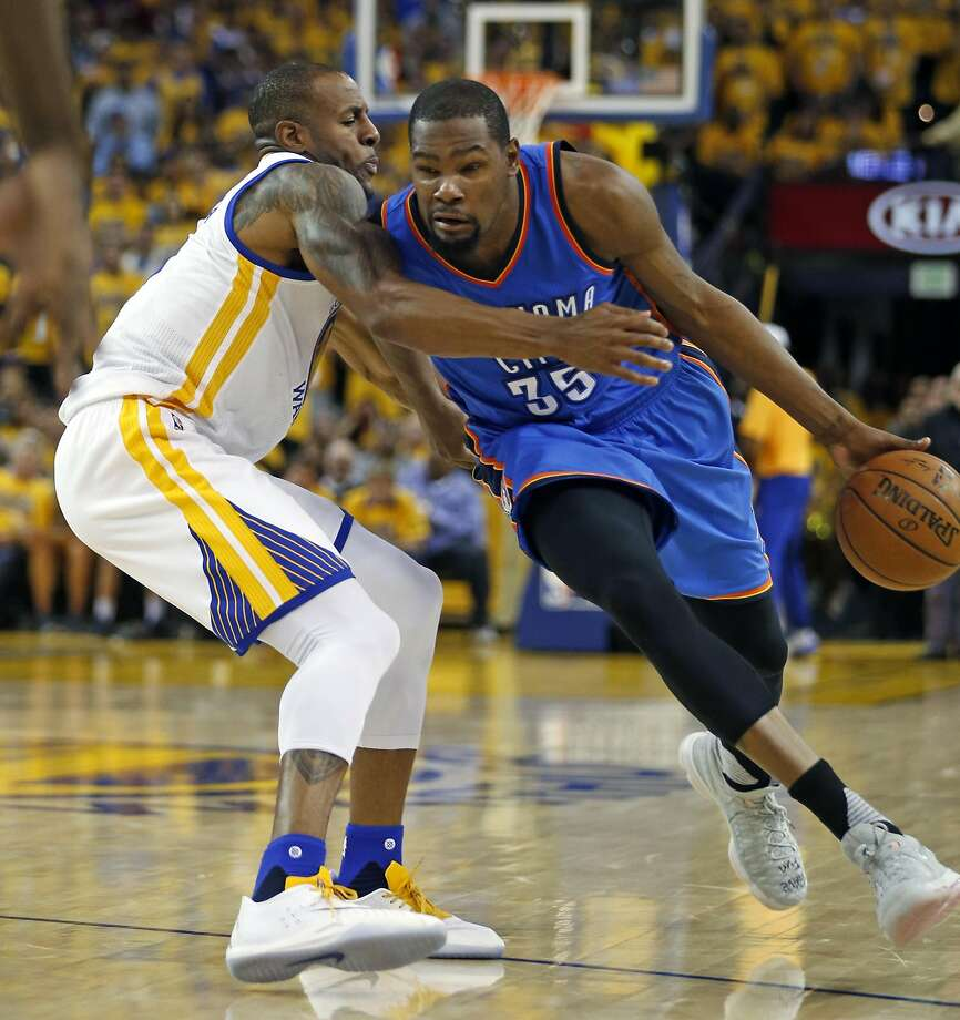 Golden State Warriors' Andre Iguodala guards Oklahoma City Thunder's Kevin Durant during Warriors' 120-111 win in Game 5 of NBA Playoffs' Western Conference Finals at Oracle Arena in Oakland, Calif., on Thursday, May 26, 2016. Photo: Scott Strazzante, The Chronicle