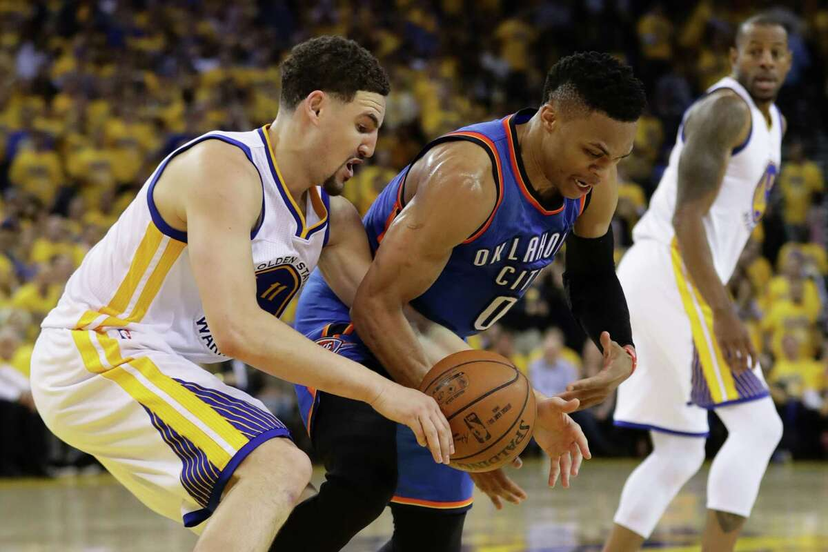OAKLAND, CA - MAY 26: Klay Thompson #11 of the Golden State Warriors and Russell Westbrook #0 of the Oklahoma City Thunder fight for a loose ball during Game Five of the Western Conference Finals during the 2016 NBA Playoffs at ORACLE Arena on May 26, 2016 in Oakland, California. (Photo by Ezra Shaw/Getty Images) ORG XMIT: 639707819