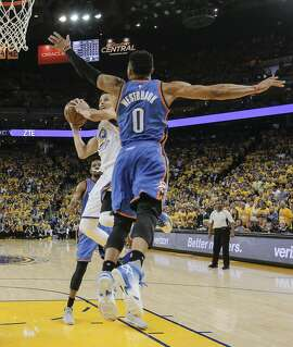Golden State Warriors� Stephen Curry attempts a layup against Oklahoma City Thunders� Russell Westbrook during Game 5 of the NBA Western Conference Finals at Oracle Arena on Thursday, May 26, 2016 in Oakland, Calif.