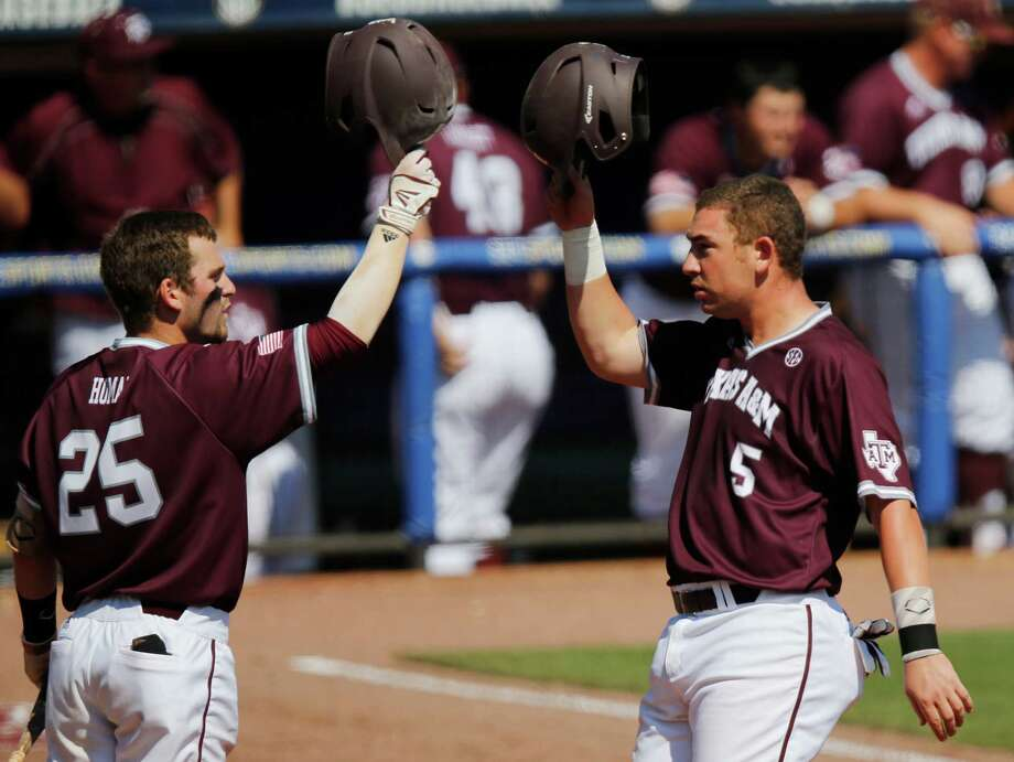 Texas A&M's Austin Homan, left, and Michael Barash acknowledge Barash's second-inning in the Aggies' 4-1 victory over South Carolina. Photo: Brynn Anderson, STF / Copyright 2016 The Associated Press. All rights reserved. This material may not be published, broadcast, rewritten or redistribu