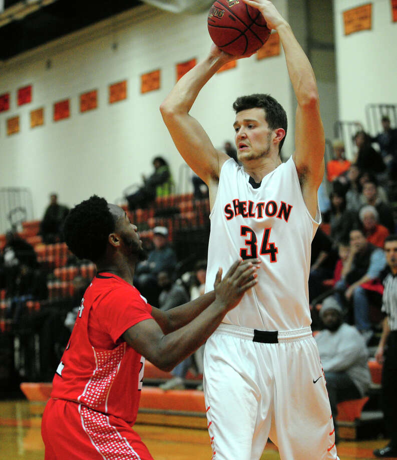 Boys basketball action between Shelton and Wilbur Cross in Shelton, Conn. on Saturday Jan. 30, 2016. Ed Conklin Photo: Christian Abraham / Hearst Connecticut Media / Connecticut Post