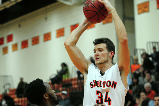 Boys basketball action between Shelton and Wilbur Cross in Shelton, Conn. on Saturday Jan. 30, 2016. Ed Conklin