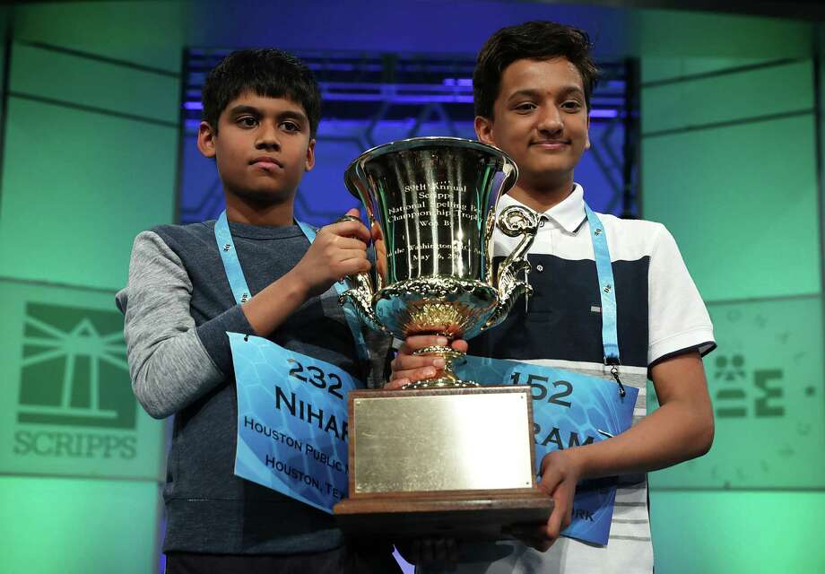 NATIONAL HARBOR, MD - MAY 26:  Nihar Saireddy Janga (L) of Austin, Texas, and Jairam Jagadeesh Hathwar of Painted Post, New York, hold a trophy after the finals of the 2016 Scripps National Spelling Bee May 26, 2016 in National Harbor, Maryland. Both spellers were declared co-champions at the end of the annual spelling competition.  (Photo by Alex Wong/Getty Images) Photo: Alex Wong / 2016 Getty Images