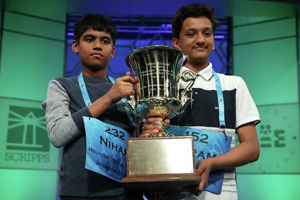 NATIONAL HARBOR, MD - MAY 26:  Nihar Saireddy Janga (L) of Austin, Texas, and Jairam Jagadeesh Hathwar of Painted Post, New York, hold a trophy after the finals of the 2016 Scripps National Spelling Bee May 26, 2016 in National Harbor, Maryland. Both spellers were declared co-champions at the end of the annual spelling competition.  (Photo by Alex Wong/Getty Images) ORG XMIT: 642306057