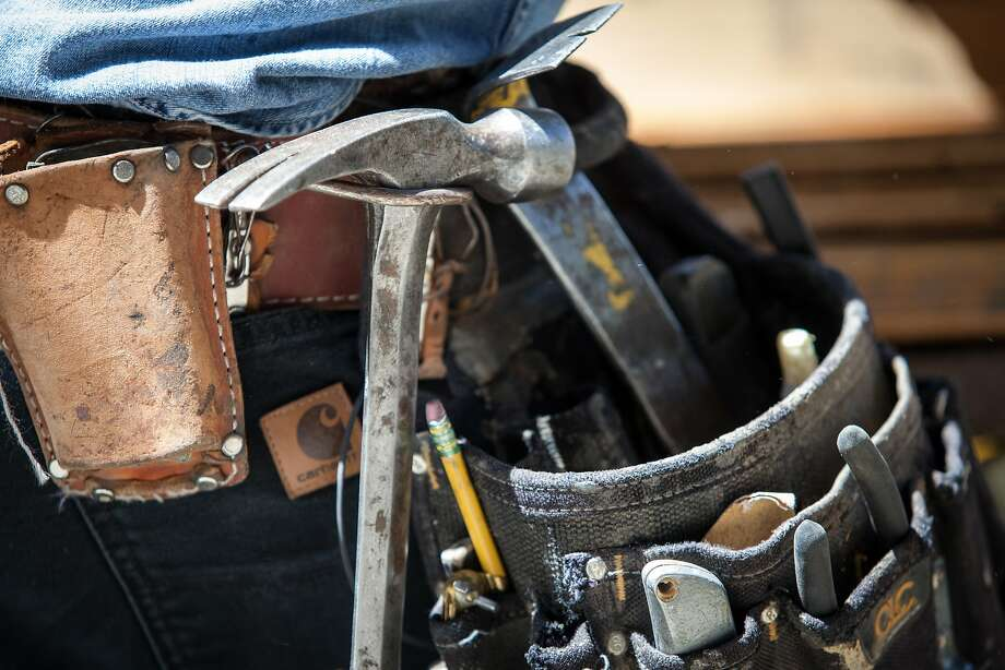 Skeeter Jones' tool belt. He says he's done the facades of more than 100 homes. Photo: Santiago Mejia, Special To The Chronicle