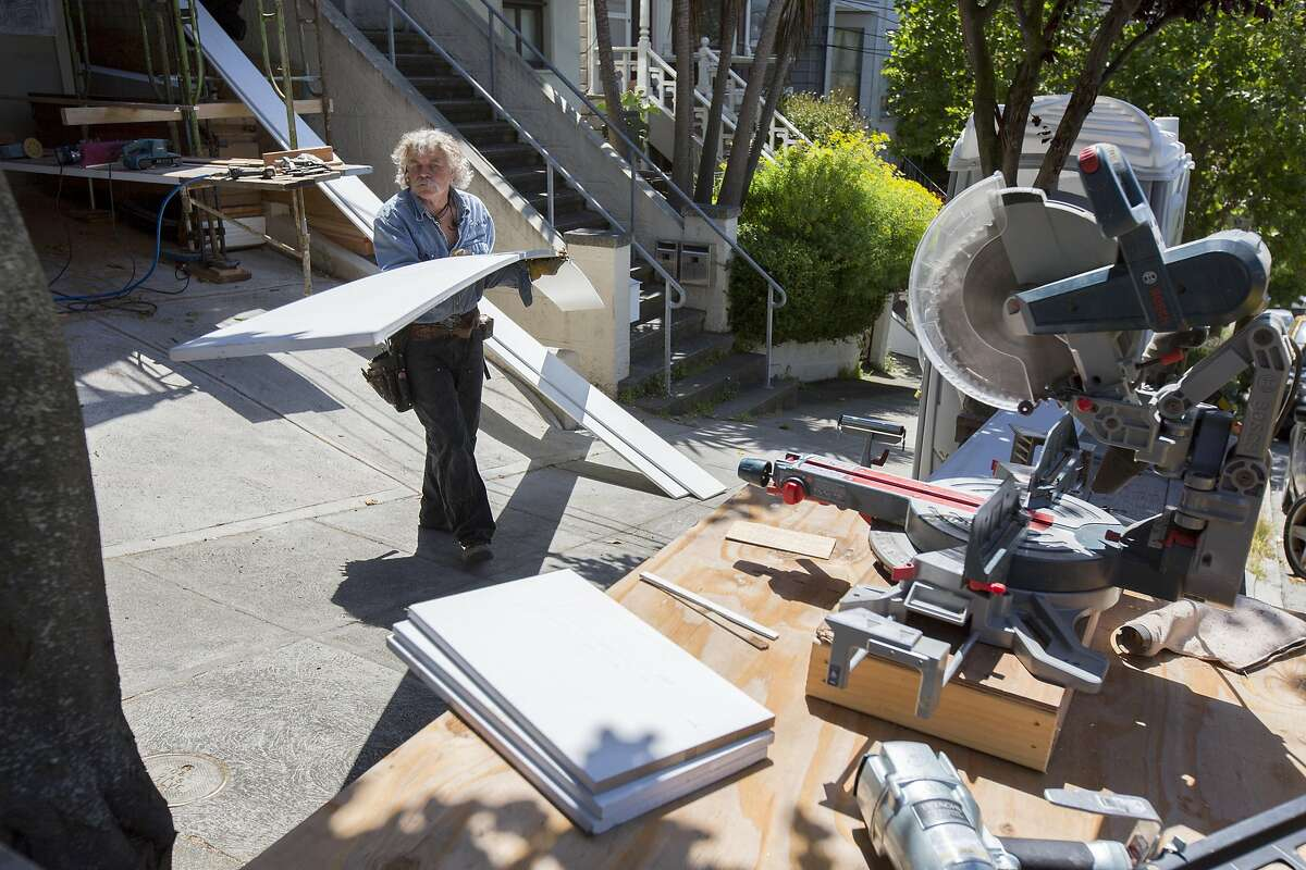 Skeeter Jones hauls planks, to be cut for the facade of a home, near 20th and Noe streets, on Thursday, May 26, 2016 in San Francisco, Calif. Jones rebuilds houses with Victorian-style facades of his own designs. He said he's done the facades of more than 100 homes.