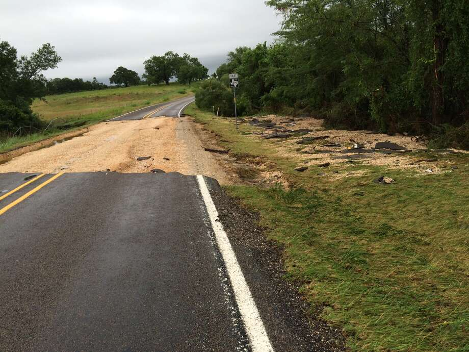Heavy rains caused overnight flooding in parts of the Houston metro region Thursday night, leading to a giant sinkhole north of town. The sinkhole appeared on Farm-to-Market Road 2621 in the unincorporated community of Independence, north of Brenham. The road is now closed (obviously). Photo: Kyrie O'Connor