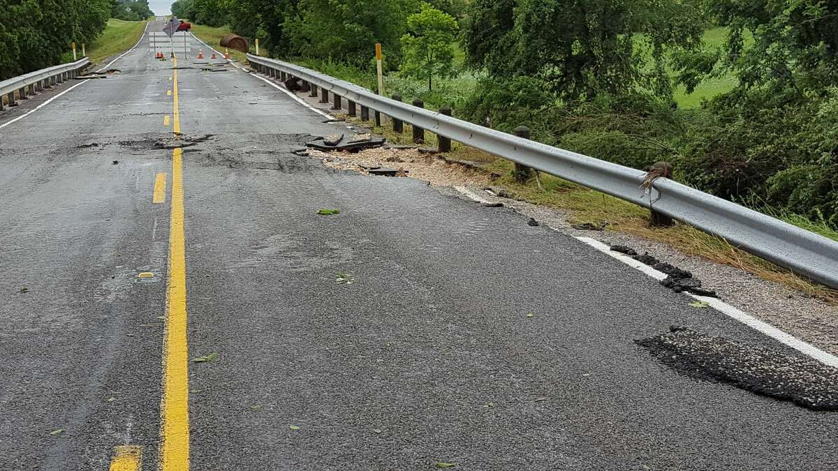 Heavy rains caused overnight flooding in parts of the Houston metro region Thursday night, leading to a giant sinkhole north of town. The sinkhole appeared on Farm-to-Market Road 2621 in the unincorporated community of Independence, north of Brenham. The road is now closed (obviously).