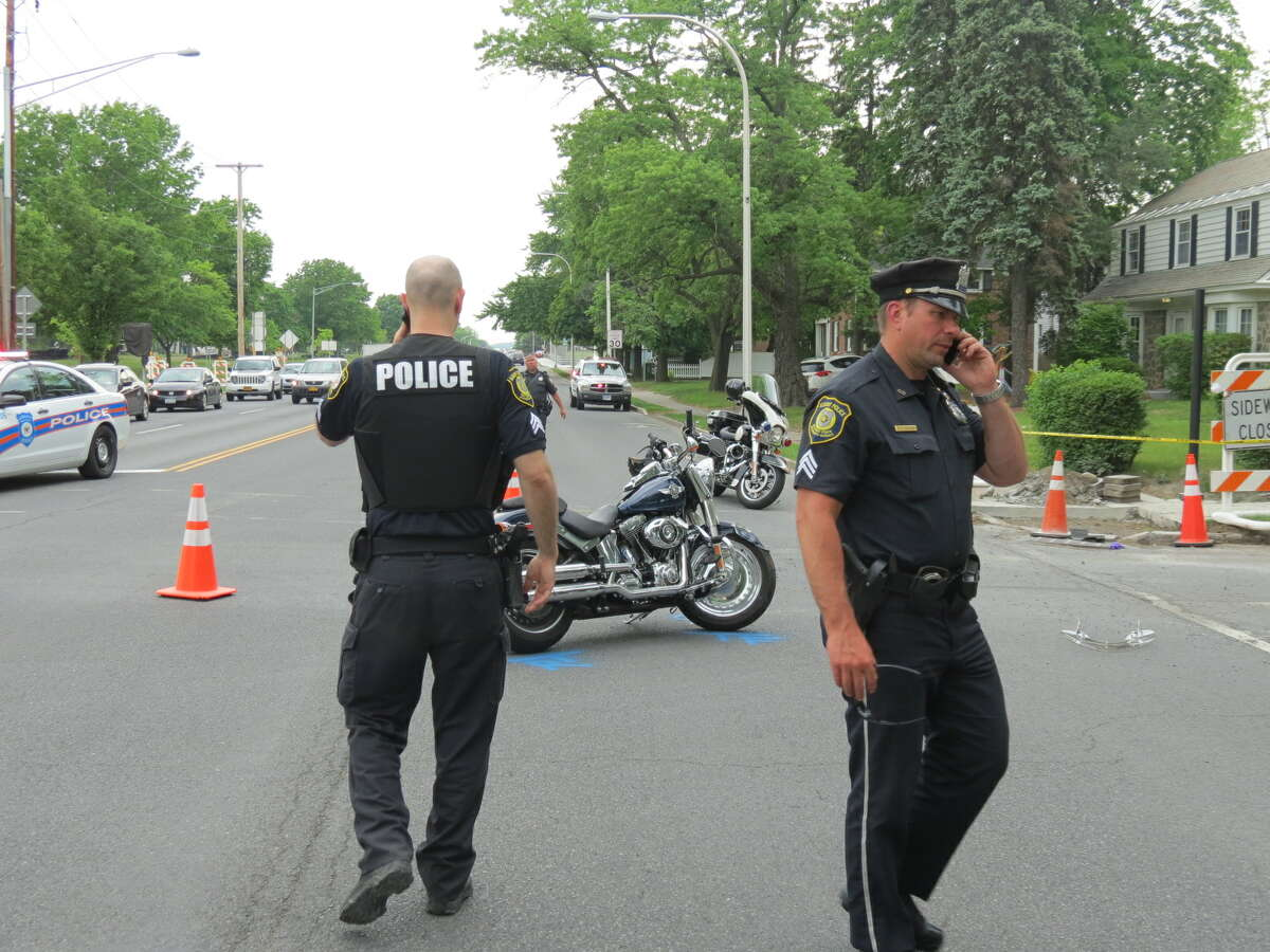 Albany police investigate a motorcycle-SUV crash at 4:15 p.m. Thursday at the intersection of Washington Avenue and Brevator Street. (Tom Heffernan Sr./Special to the Times Union)