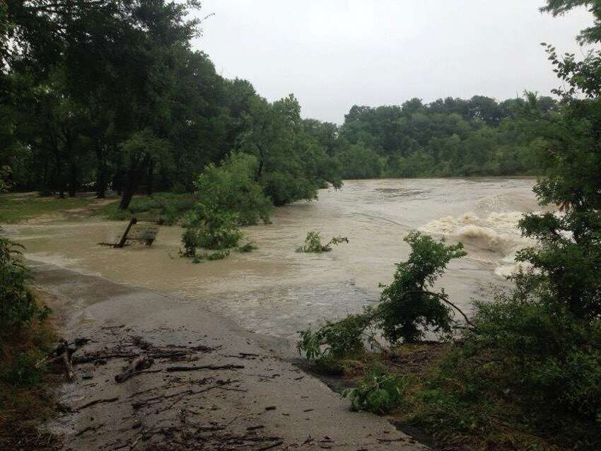 Heavy rains have caused flooding at some Texas state parks, like this view from McKinney Falls in Austin.