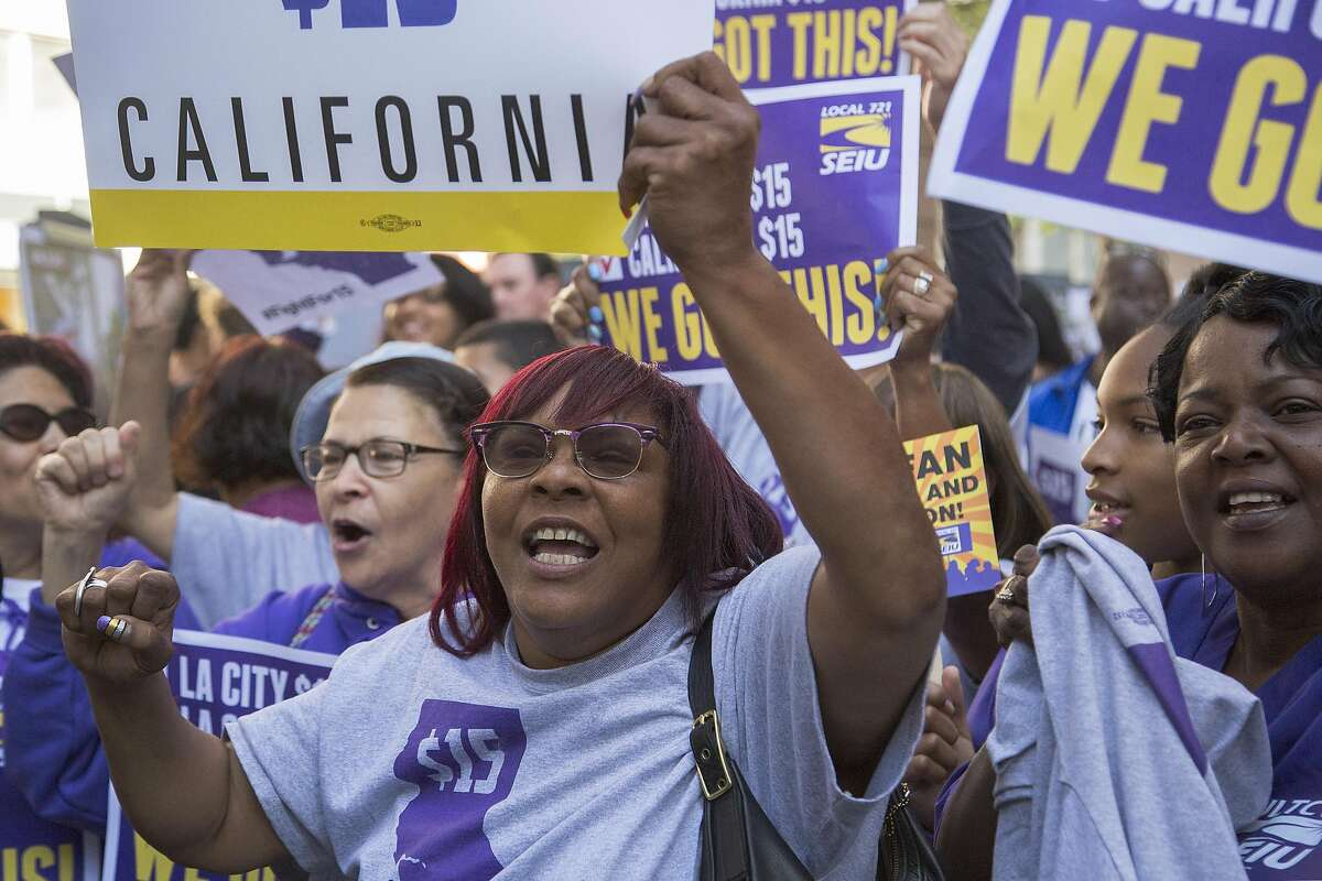 LOS ANGELES, CALIFORNIA - APRIL 04: Service Employees International Union members celebrate after California Governor Jerry Brown signed landmark legislation SB 3 into law on April 4, 2016 in Los Angeles, California. The law makes California the first state in the nation to commit to raising the minimum wage to $15 per hour statewide. (Photo by David McNew/Getty Images)