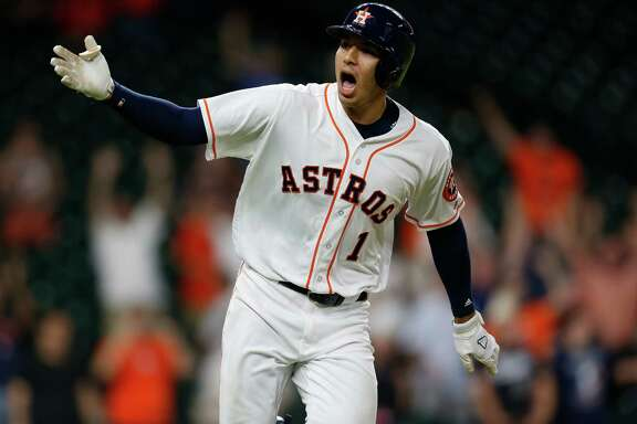 Houston Astros shortstop Carlos Correa (1) reacts after his RBI single wins the game during the thirteenth inning of an MLB baseball game at Minute Maid Park, Tuesday, May 24, 2016.  ( Karen Warren  / Houston Chronicle )