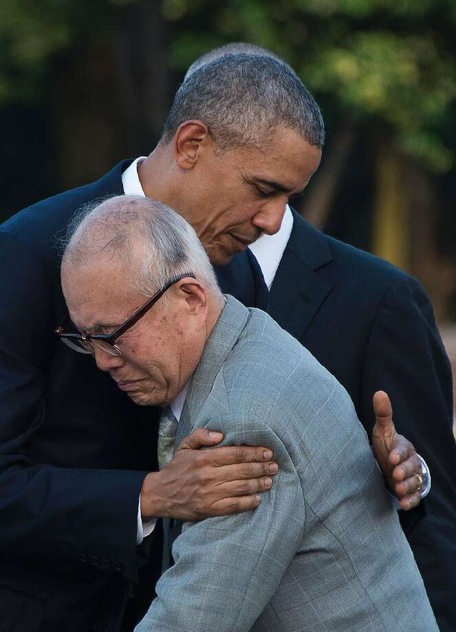President Obama hugs Shigeaki Mori, a survivor of the 1945 atomic bombing of Hiroshima, during a visit to the Hiroshima Peace Memorial Park. Photo: JIM WATSON, AFP/Getty Images