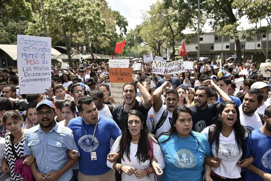Students march against the government Thursday in Caracas, Venezuela. The opposition is pushing to recall President Nicolas Maduro, blaming him for shortages of basic necessities. Photo: Carlos Becerra, Bloomberg