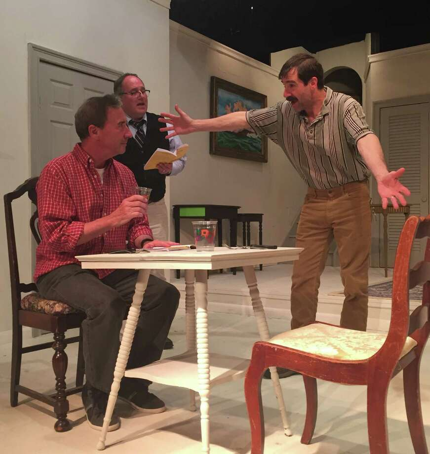 """The Foreigner"" is on stage in Newtown this month, presented by the Town Players. The show opens Friday, June 3, and runs through Saturday, June 25. Working on a scene are Bob Filipowich of Fairfield, Frank Arnone of Newtown, and Timothy Huebenthal of Southbury. Photo: Contributed Photo"
