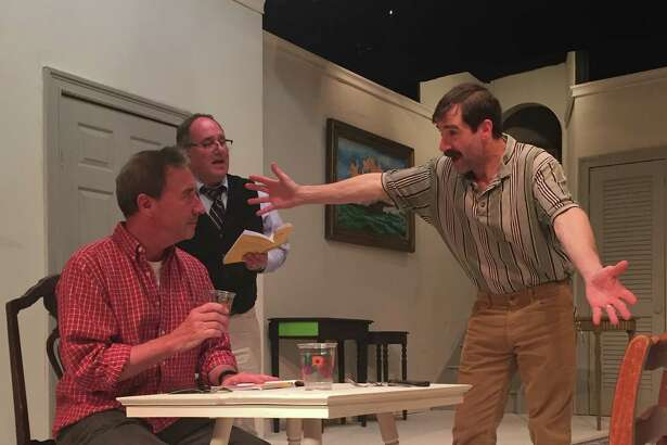 """""""The Foreigner"""" is on stage in Newtown this month, presented by the Town Players. The show opens Friday, June 3, and runs through Saturday, June 25. Working on a scene are Bob Filipowich of Fairfield, Frank Arnone of Newtown, and Timothy Huebenthal of Southbury."""