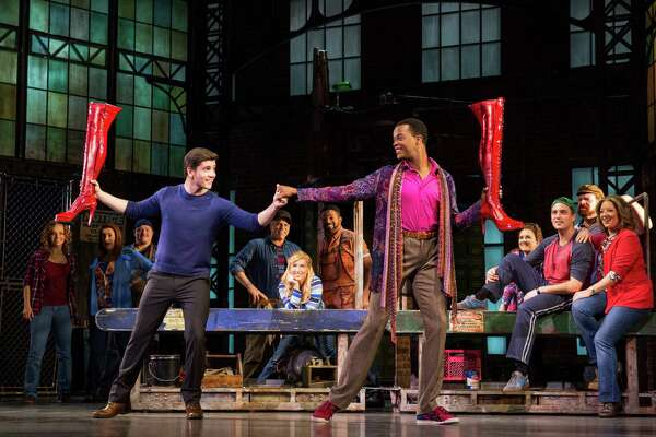 "Adam Kaplan, left, and J. Harrison Ghee play unlikely allies in the musical ""Kinky Boots,"" on stage at the Shubert Theatre, Wednesday, June 8, through Sunday, June 12."