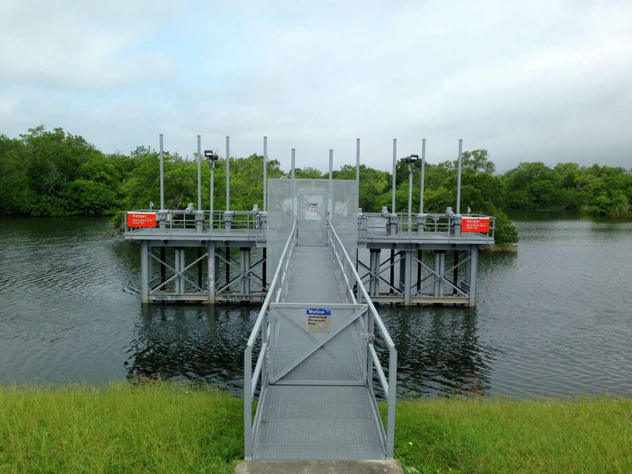 On May 17, 2016, the platform containing the control panel for the gates at Barker Dam stood in what would normally be an empty reservoir and park. Photo: Susan Chadwick