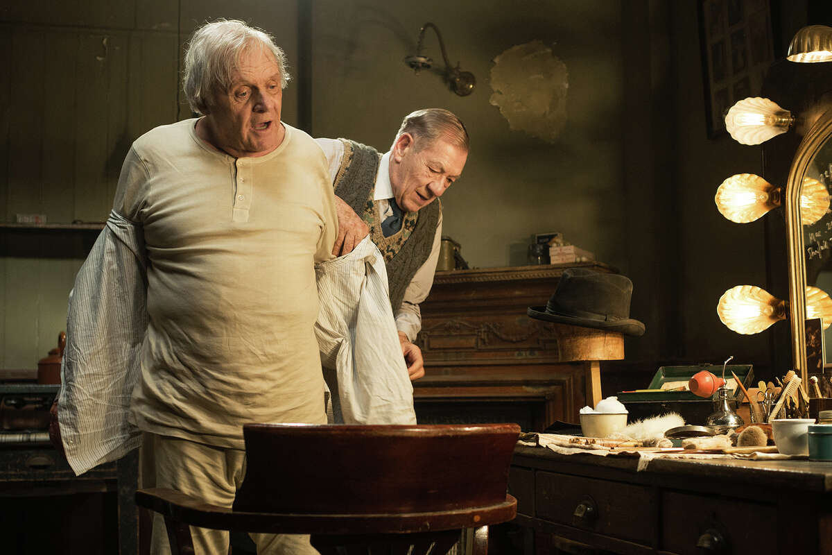 The aging, fading star Sir (Anthony Hopkins) with his dresser, Norman (Ian McKellen), whose relationship oddly echos what's on stage.