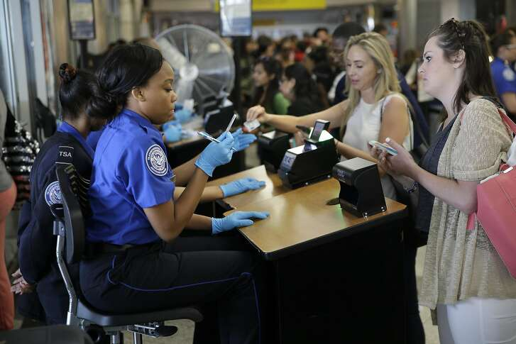 Transportation Security Administration employees check passengers' identifications at a security checkpoint at LaGuardia Airport in New York, Thursday, May 26, 2016. The TSA will add 768 new screeners by mid-June to deal with increasingly long airport security lines that have caused passengers to miss flights even before the busy summer travel season, the agency's chief told Congress on Wednesday. Most of the new screeners will be sent to the nation's busiest airports in Chicago, New York, Atlanta, Los Angeles and other hubs. (AP Photo/Seth Wenig)