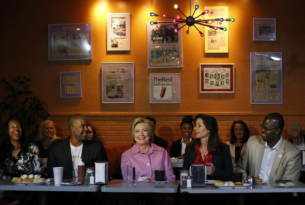 Presidential candidate Hillary Clinton, center, meets with from left, Regina Jackson, CEO of East Oakland Youth Development Center, Derreck Johnson, Owner of Home of Chicken and Waffles, Mayor Libby Schaaf, OSUSD Superintendent Antwan Wilson and Alameda County Supervisor Wilma Chan in the Home of Chicken and Waffles May 27, 2016 in Oakland, Calif. Clinton met with Mayor Schaaf and other community members to discuss local issues.