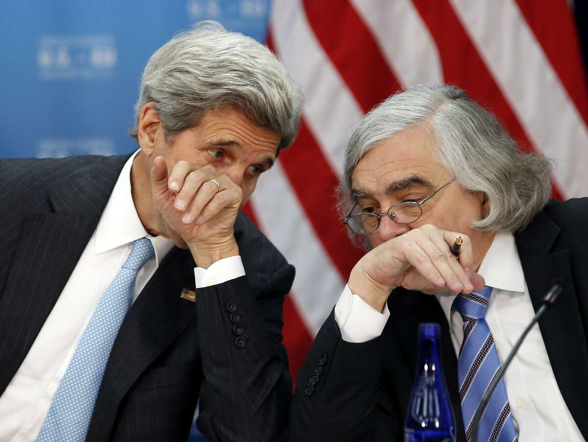 Secretary of State John Kerry, left, speaks with Secretary of Energy Ernest Moniz during the seventh U.S. � E.U. Energy Security Council meeting, during the U.S. Caribbean-Central American Energy Summit at the State Department, Wednesday, May 4, 2016 in Washington. (AP Photo/Alex Brandon)