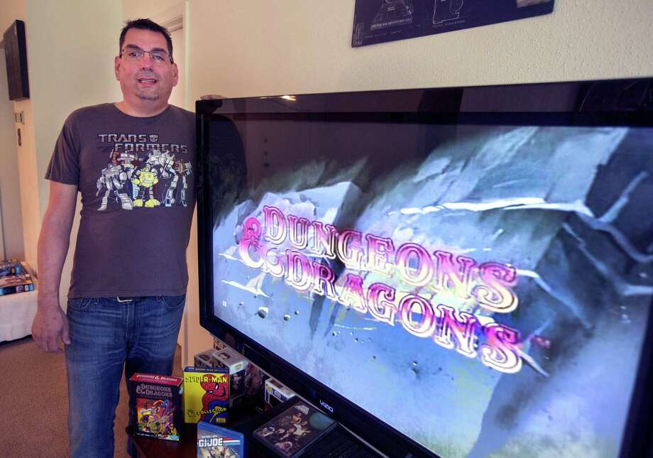 Jason Davis showing one of his favorite cartoons. He will be screening Saturday morning cartoons at the Park North Drafthouse in June. Photo: William Luther /San Antonio Express-News / (c)2015 William Luther
