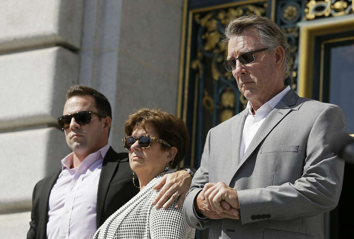 ** HOLD FOR OVERNIGHT MOVEMENT ** File - In this Sept. 1, 2015 file photo, from left, Brad Steinle, Liz Sullivan and Jim Steinle, the brother, mother and father of Kathryn Steinle who was shot to death on a pier, listen to their attorneys speak during a news conference on the steps of City Hall in San Francisco. San Francisco supervisors vote Tuesday, May 10, 2016, on a proposal to further tighten the city�s sanctuary ordinance, allowing cooperation with federal immigration authorities only in very limited cases involving violent felons. This comes nearly a year after a 32-year-old woman was shot in the back by a Mexican national who was in the country illegally, setting off a national debate over sanctuary protections. (AP Photo/Eric Risberg, File)
