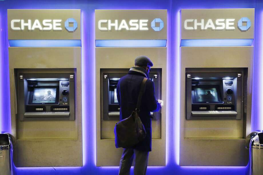 JPMorgan Chase, Wells Fargo and other big banks are upgrading their online payment services. Photo: Mark Lennihan, Associated Press