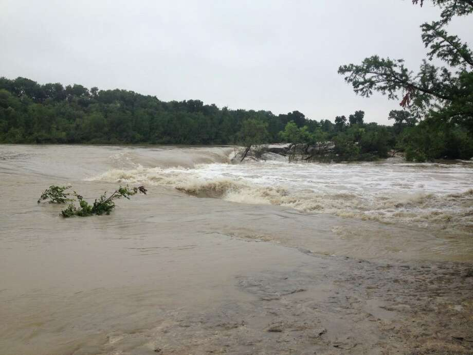 Heavy rains have caused flooding at some Texas state parks, like this view from McKinney Falls in Austin. Photo: Courtesy Of Texas Parks And Wildlife