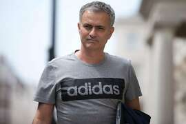 TOPSHOT - Manchester United's new Portuguese manager Jose Mourinho returns to his home in central London on May 27, 2016. Manchester United on Friday anointed Jose Mourinho as their new manager to launch a third bid in less than three years to transform the Red Devils into a title-winning force again. After three days of talks, Mourinho agreed a three-year contract on a bumper salary reportedly worth more than $20 million (19.5 million euros) a year. / AFP PHOTO / JUSTIN TALLISJUSTIN TALLIS/AFP/Getty Images