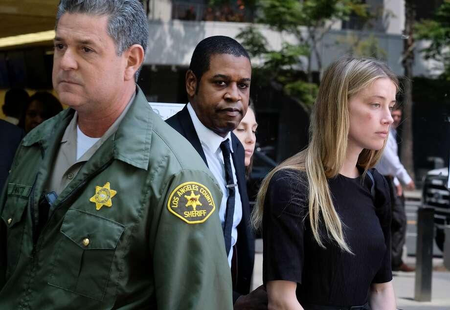 Actress Amber Heard leaves Los Angeles County Superior Court after giving a sworn declaration that husband Johnny Depp threw her cell phone at her during a fight last weekend. Photo: Richard Vogel, Associated Press
