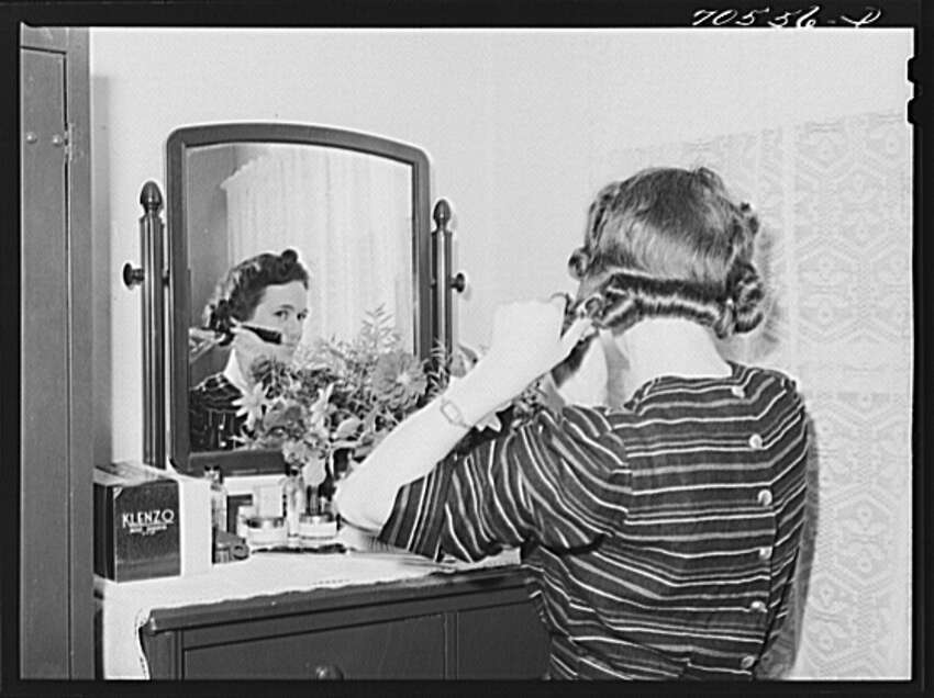 A woman is pictured in October 1941 at a Farm Security Administration dorm at the U.S. Navy shipyard in Bremerton.