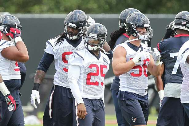 Cornerback Kareem Jackson, center, and linebackers Jadeveon Clowney, left, and Brian Cushing are among those expected to be key contributors for a Texans defense that was ranked third in the NFL last season.