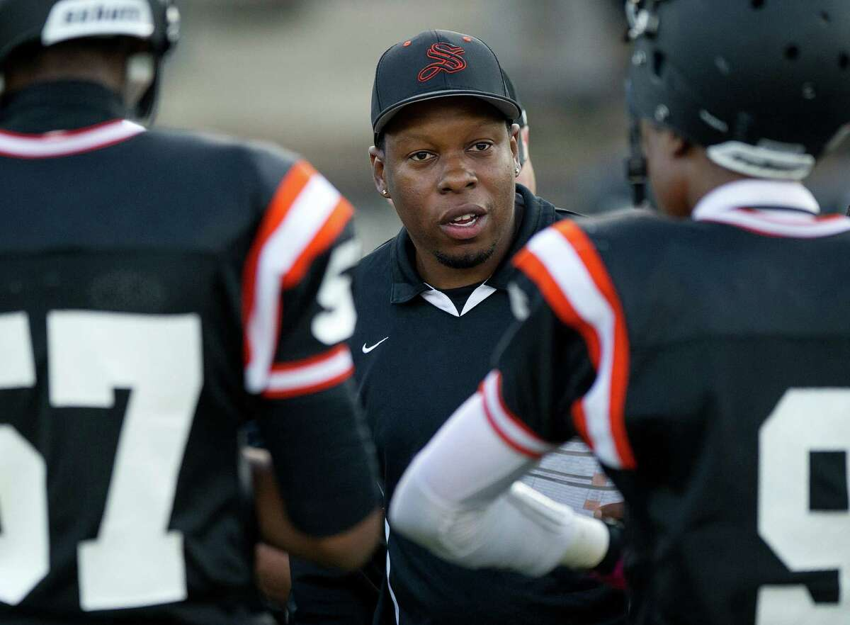 Coach Jamar Greene talks to his team during Friday's spring football game at Stamford High School on June 14, 2013.